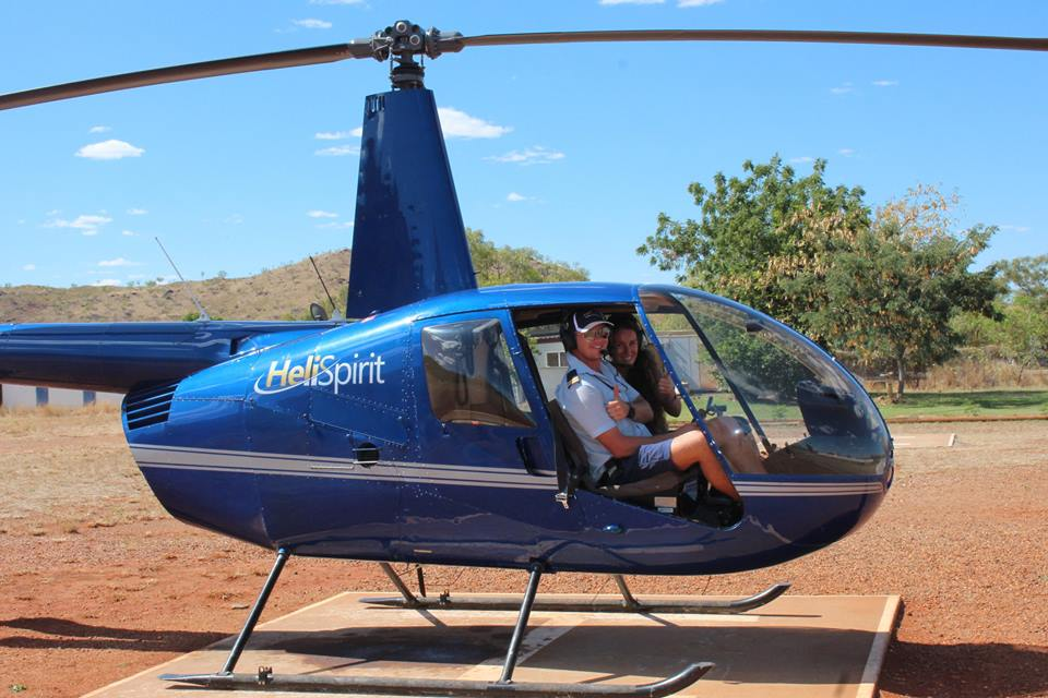 Ana hitchhiking by helicopter