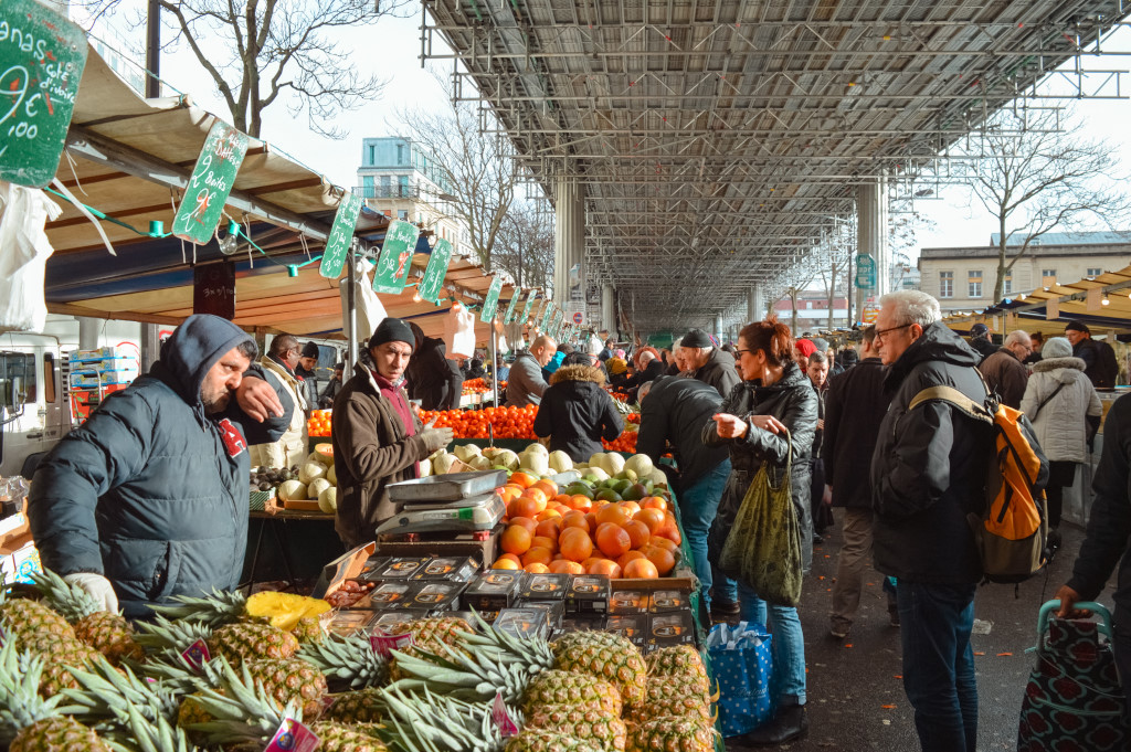 Market vendors selling fruit and vegetables at the Boulevard de la Chapelle