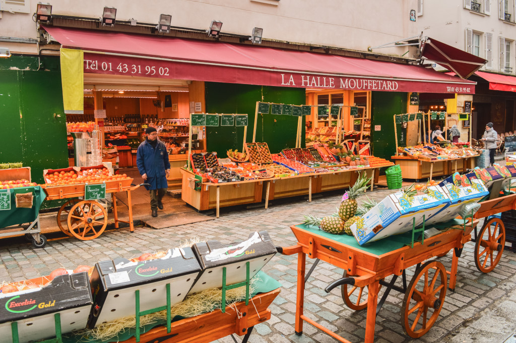 A market stall with ample fruits and vegetables in Rue Mouffetard