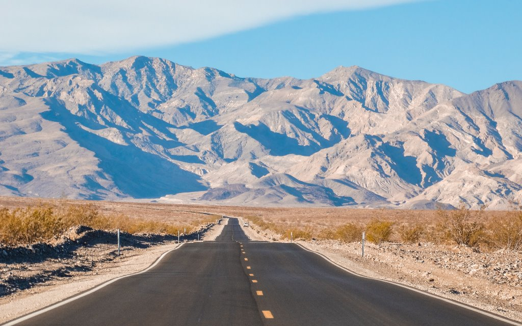 An American road trip across Death Valley produces stunning sights: sand dunes, mountains, and salt flats.