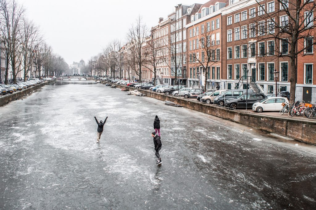 Ice skaters celebrate the winter on the frozen canals in Amsterdam