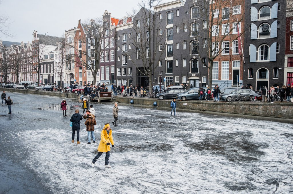 Several ice skaters on the frozen canals in Amsterdam