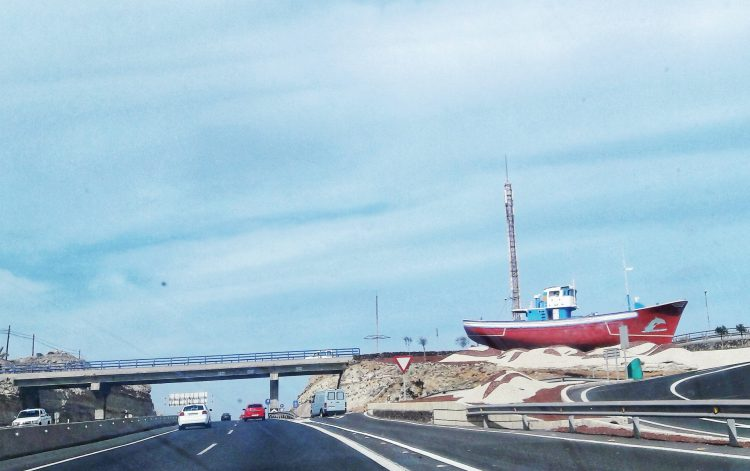 Travelling differently: Surprised by a boat near the highway