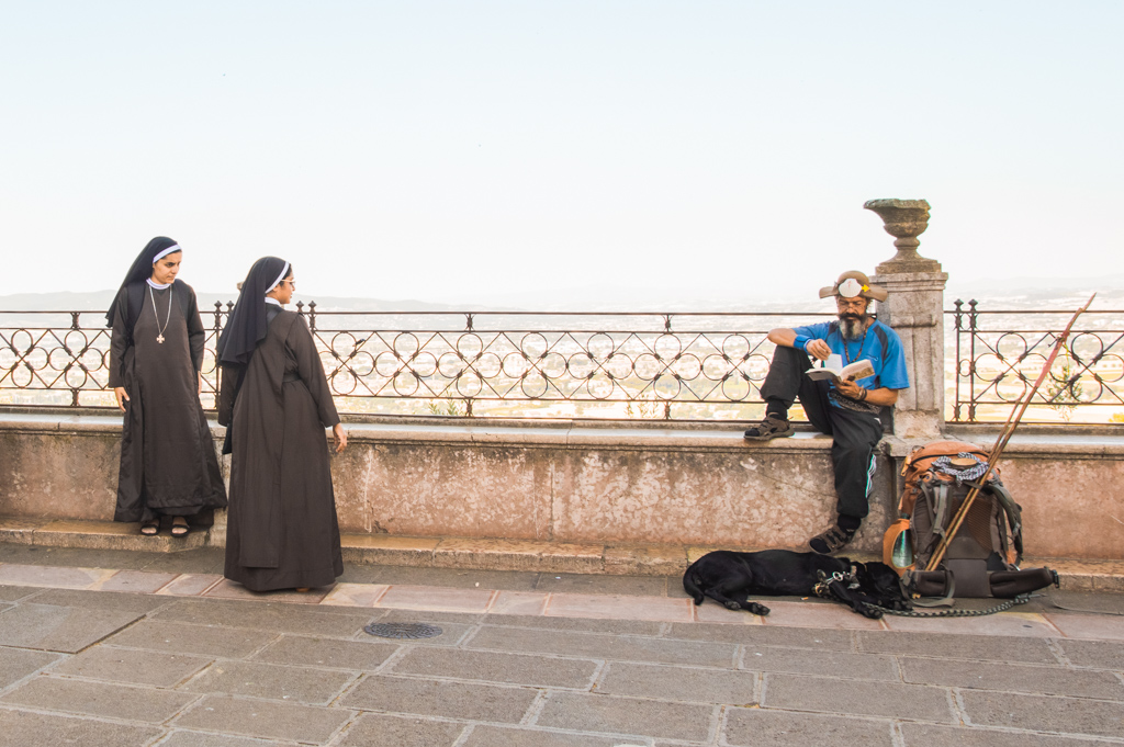 Nuns and a pilgrim in Assisi, Italy.